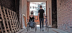 Wheelchair user and cyclist hand in hand. (Photo: Weiland)